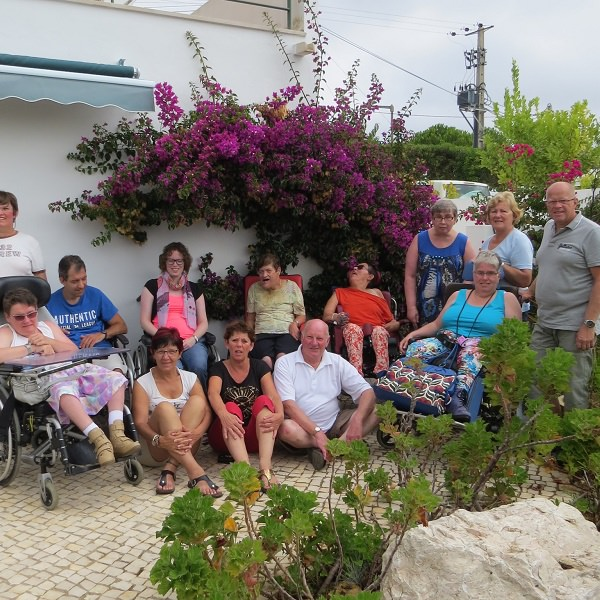 group holiday picture with wheelchair users in lagos villas enable holidays portugal algarve