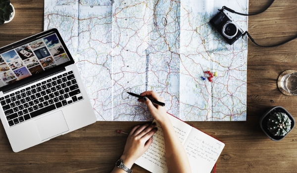 accessible-holidays-enable-holidays-wheelchair-friendly-holidays-five-top-tips-for-stress-free-accessible-holiday-planning-map-laptop-notepad.